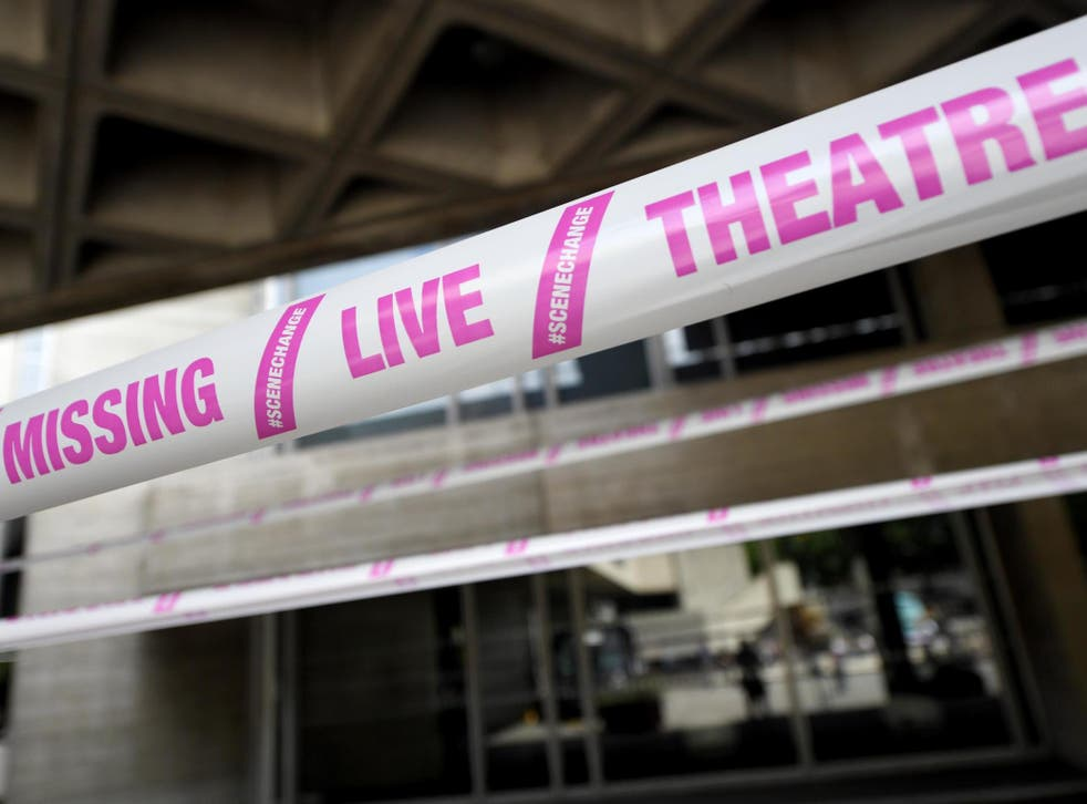 The National Theatre wrapped in pink tape as part of a campaign by #scenechange to help bring shows back into production