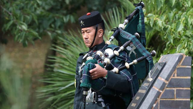 Piper Colour Sergeant Lil Bahadur Gurung attends the VJ Day National Remembrance event, held at the National Memorial Arboretum in Staffordshire, Britain