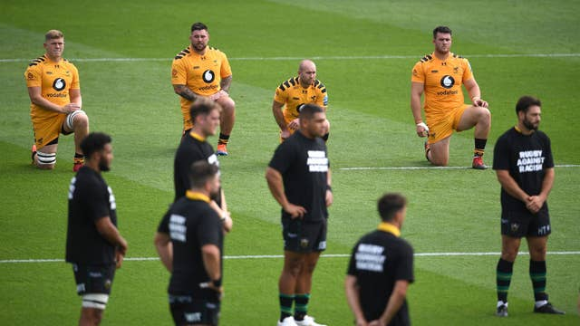 Wasp players take a knee as Northampton Saints stand prior to kick-off in their Premiership match at Franklin's Gardens