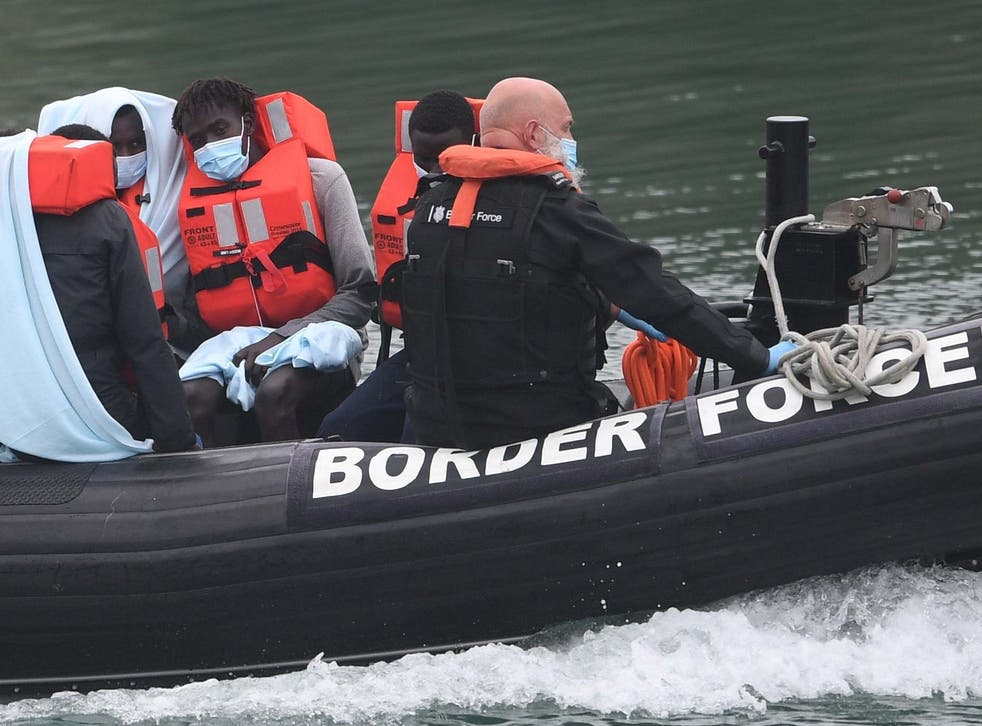 A Border Force vessel brings in migrants found off the coast of Dover on 14 August 2020