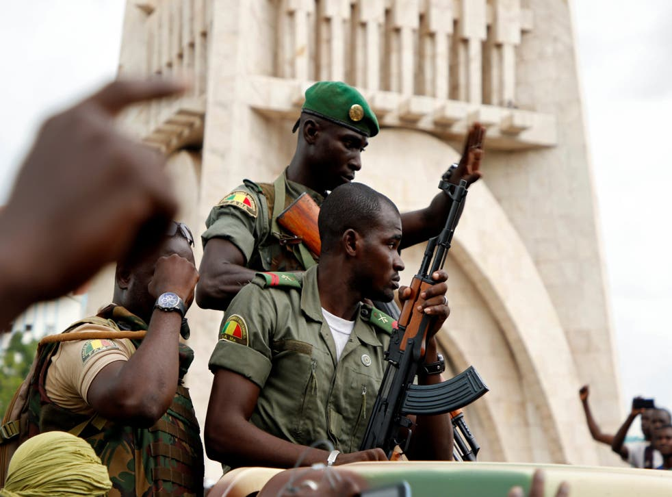Malian army soldiers are seen at the Independence Square in Bamako after a mutiny