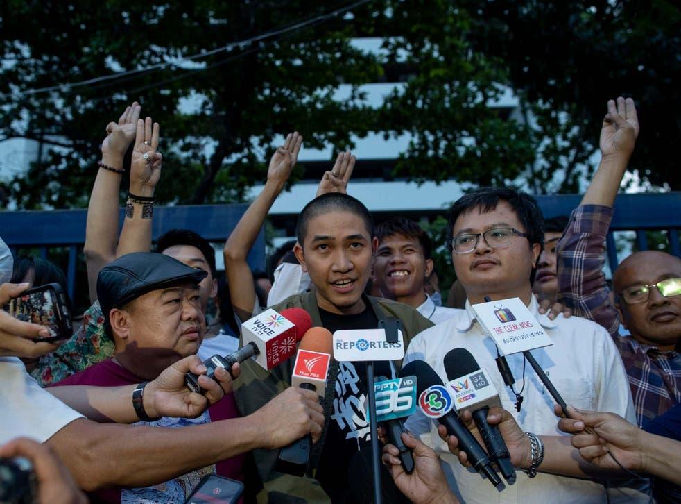 Pro-democracy activist and singer Dechathorn Bamrungmuang speaks outside the criminal courthouse in Bangkok yesterday