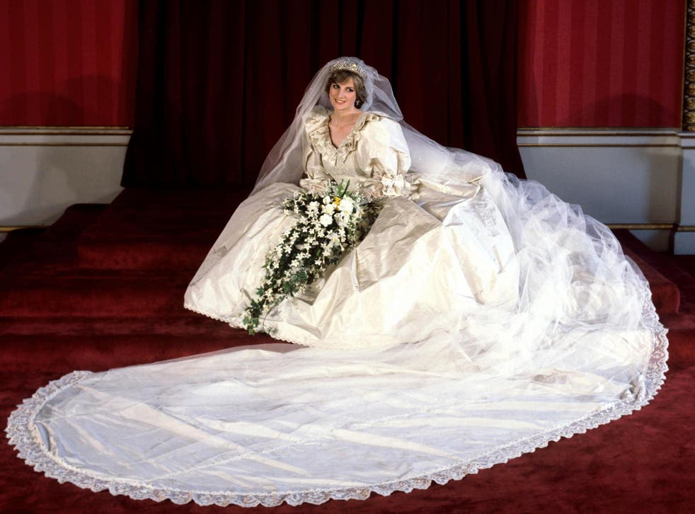 The Princess of Wales seated in her bridal gown at Buckingham Palace after her marriage to Prince Charles at St. Paul's Cathedral