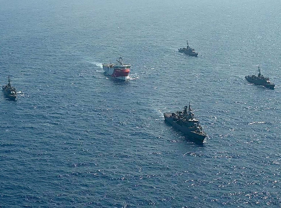 A Turkish seismic research vessel is escorted by naval ships