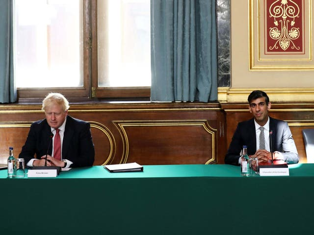 Boris Johnson and Rishi Sunak during a cabinet meeting held at the Foreign and Commonwealth Office in London