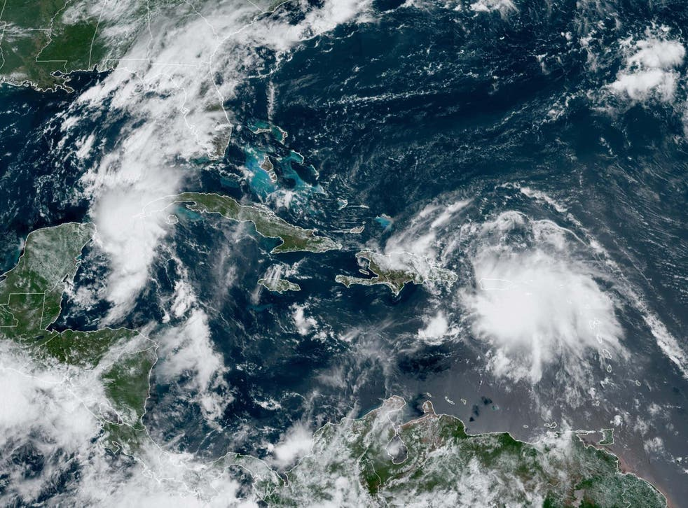 Tropical Storms Laura and Marco are both advancing across the Caribbean towards the US Gulf Coast