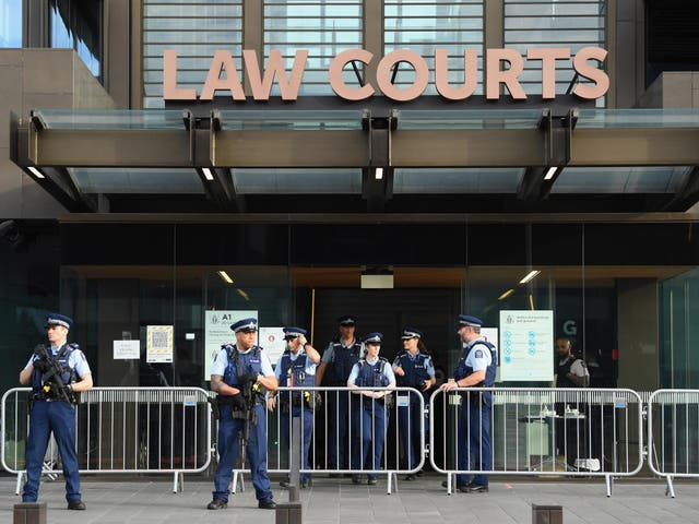 Armed police officers are seen in front of Christchurch High Court during the sentencing hearing of Brenton Tarrant