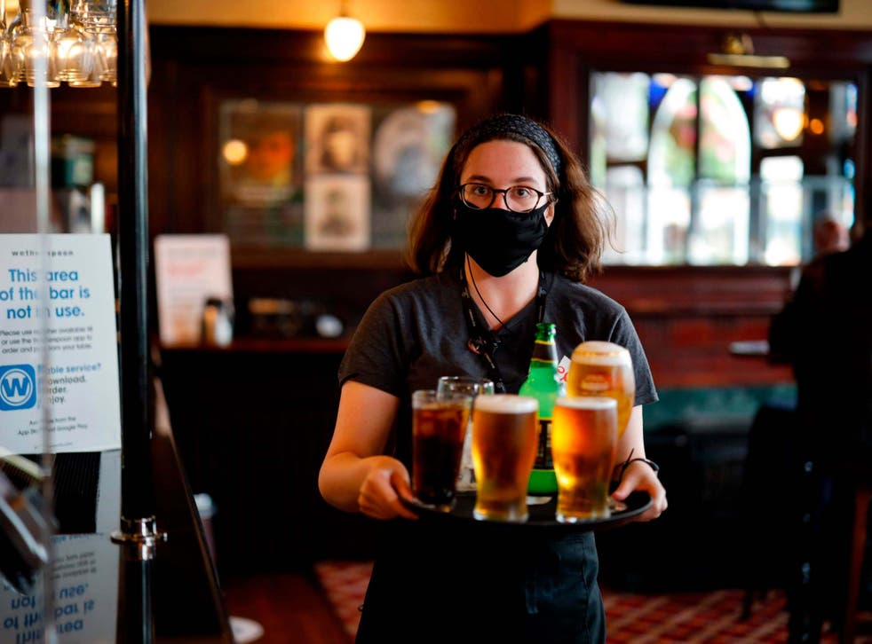 A member of staff inside a Wetherspoon in Stratford, east London