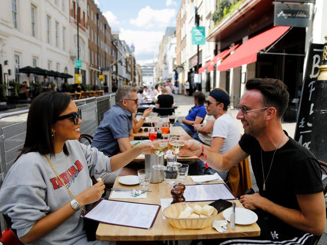 Diners enjoy their drinks at a restaurant in London on 3 August 2020 as Eat Out to Help Out scheme begins