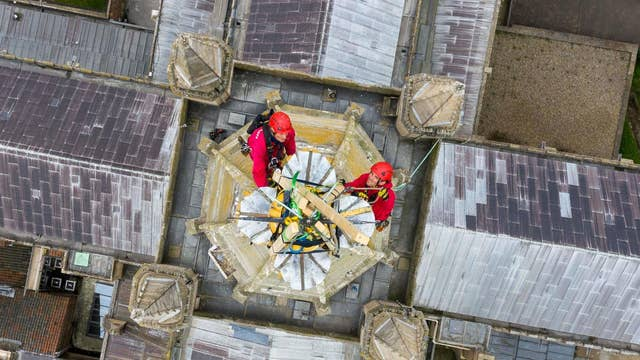 Father and son team Chris and Sam Milford from historic building conservation specialists WallWalkers begin restoration work on the spire of Norwich Cathedral, which stands at over 312ft high. The first known spire was completed in 1297