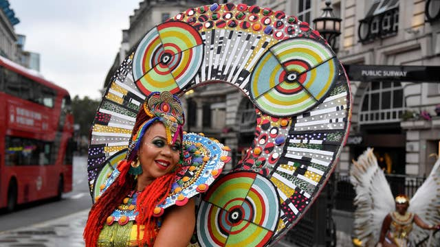 Caribbean soca dancers display their costumes as they promote the first ever digital Notting Hill Carnival, following the cancellation of the normal Carnival festivities due to the continued spread of the coronavirus disease, in London