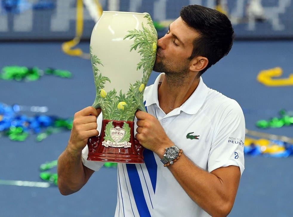 Novak Djokovic celebrates winning the Western & Southern Open