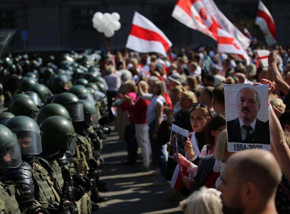 Law enforcement officers block a street during a rally of opposition supporters protesting against presidential election results in Minsk, Belarus