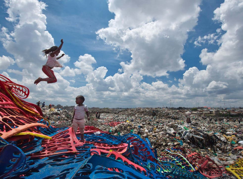 Two children play on a plastic dump in the Dandora slum of Nairobi, Kenya, before a ban on plastic bags came into force in Kenya in 2017. The oil industry has recently asked the US to pressure Kenya to change its world-leading stance against the plastic waste that litters Africa, according to environmentalists