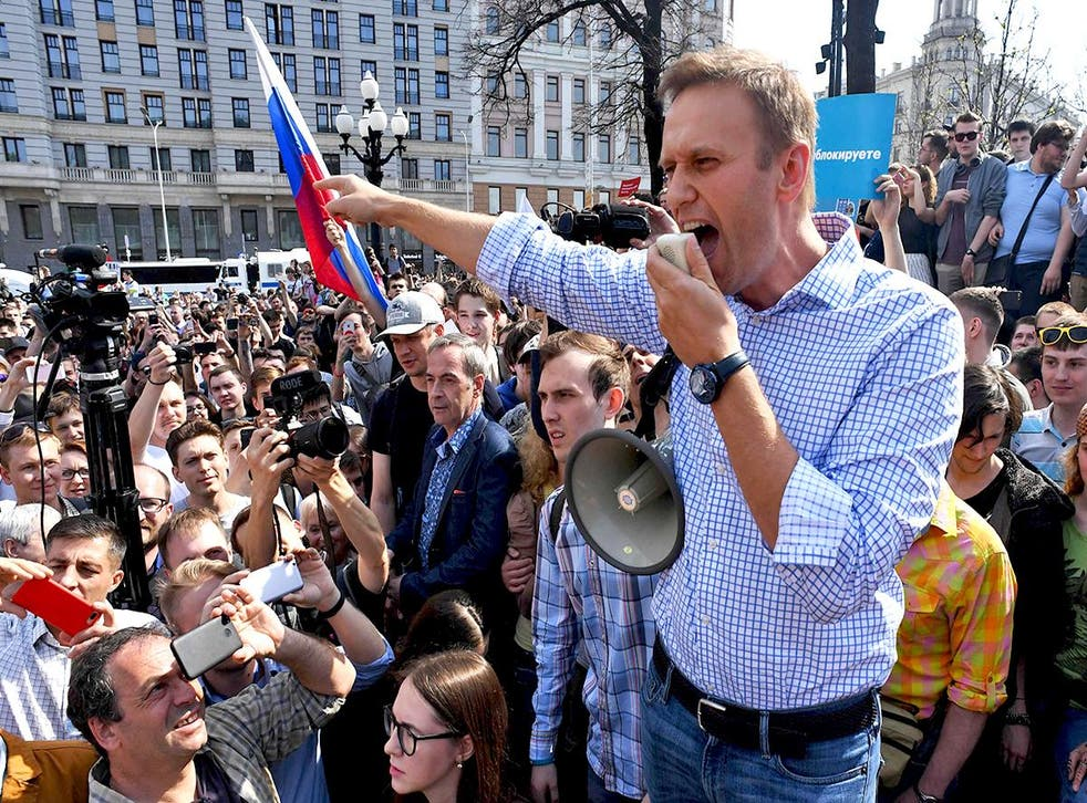 Alexei Navalny addresses supporters during an anti-Putin rally in Moscow