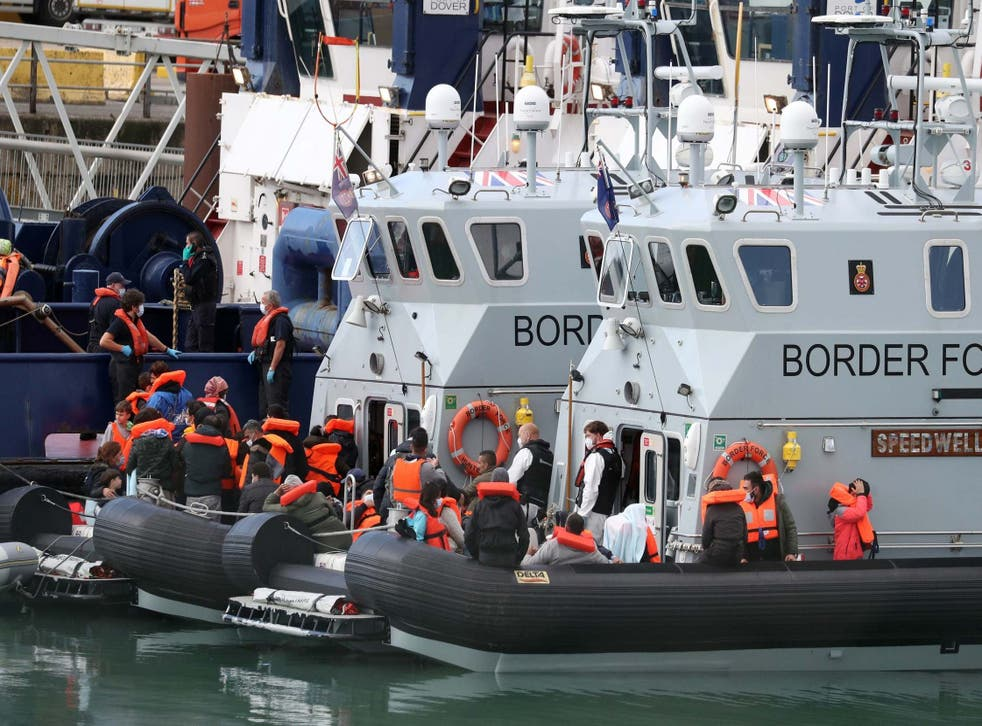 A group of people thought to be migrants are brought into Dover by Border Force officers following a small boat incident in the Channel, on Wednesday 2 September 2020