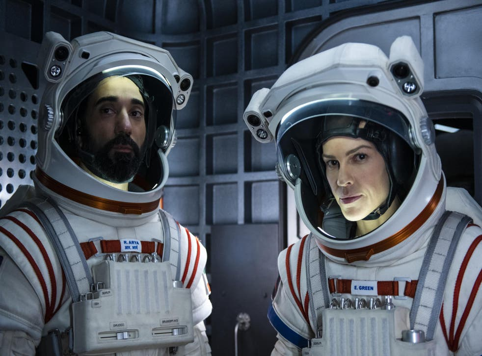 Ray Panthaki and Hilary Swank in 'Away'