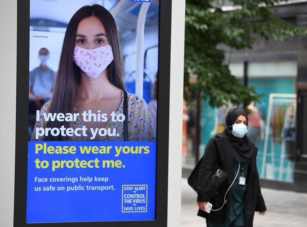 A pedestrian wears a facemask in the city centre of Leeds