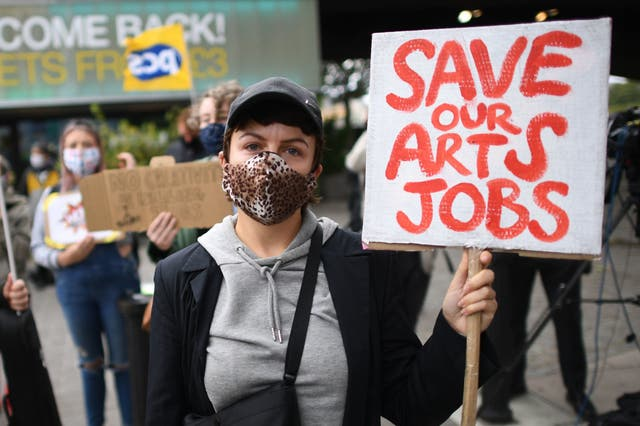 Demonstrators outside the National Theatre in central London protest against more than 1,000 redundancies being made along the South Bank