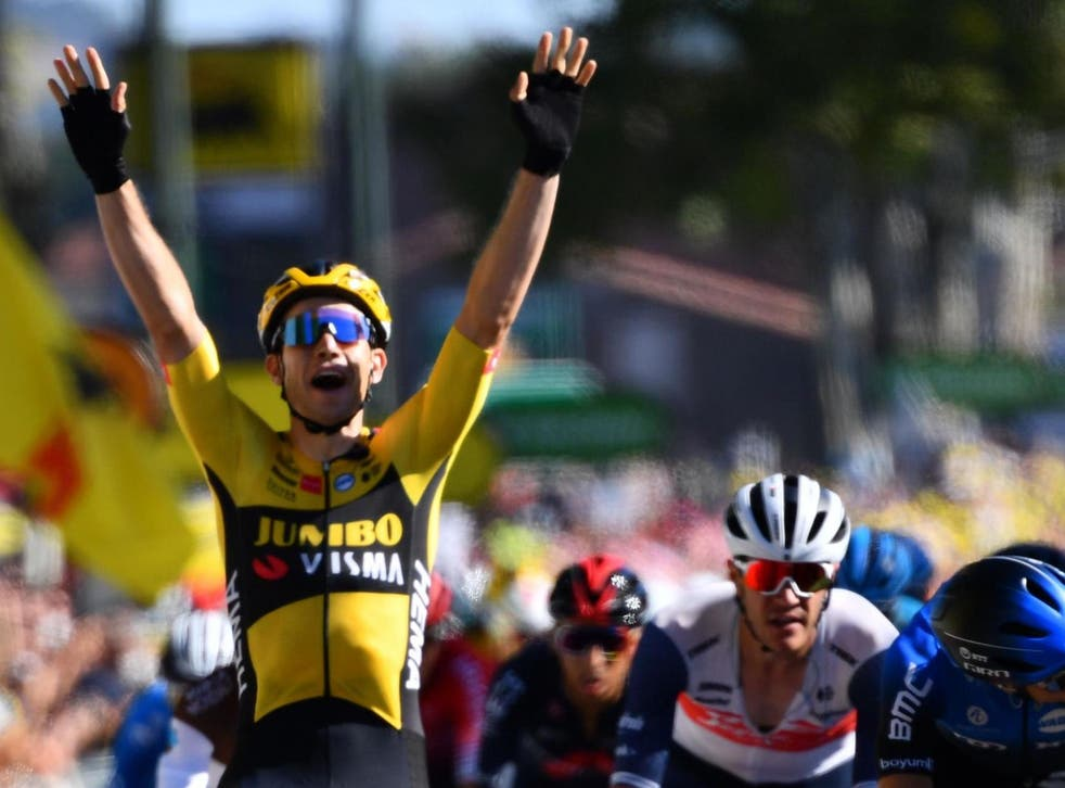 Wout van Aert celebrates winning the seventh stage of the Tour de France