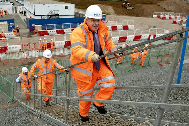 <p>Uphill struggle: Boris Johnson visits an HS2 construction site this year</p>