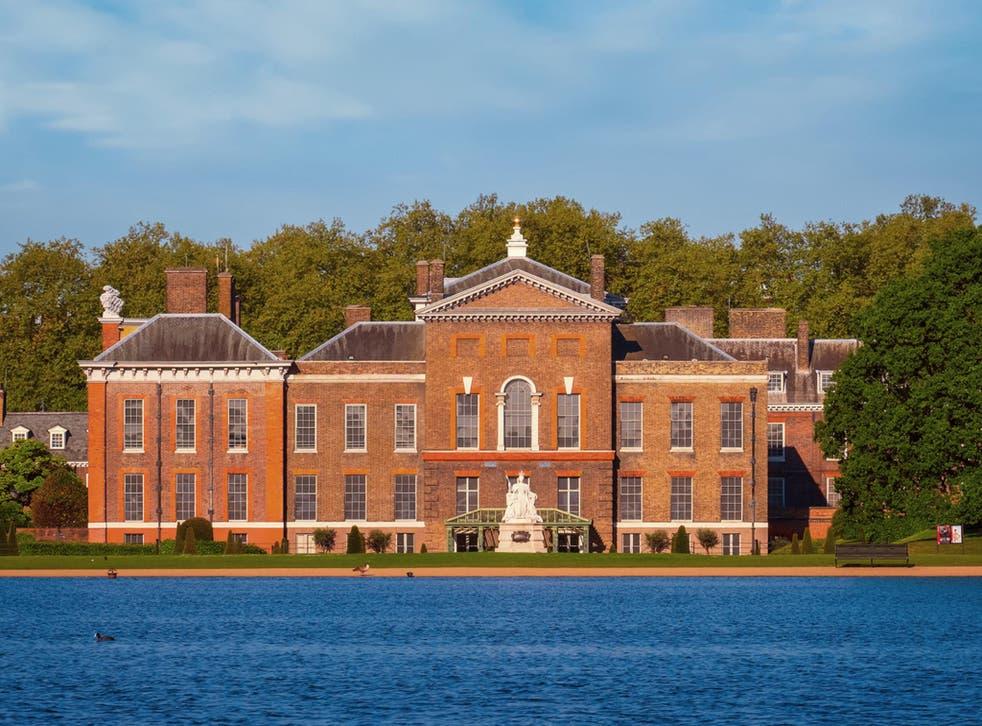 Kensington Palace overlooks the Round Pond in Kensington Gardens
