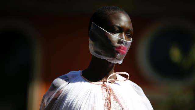 A model presents a creation during the Bora Aksu catwalk show at London Fashion Week 2020