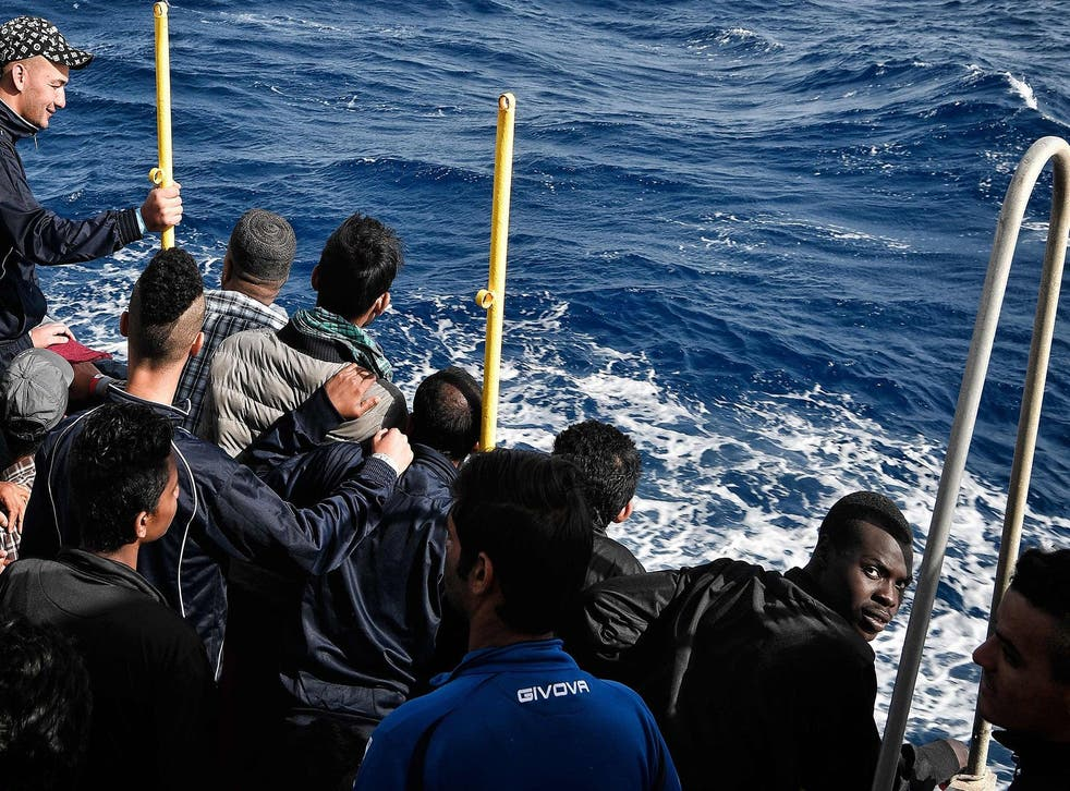 <p>Migrants aboard the rescue vessel MV Aquarius off the coast of Libya in 2018, where they were stranded for two days while Italy and the UK argued over their fate</p>