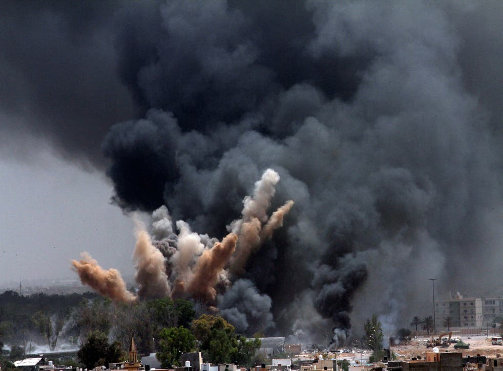 <p>Smoke rises to the sky after a Nato airstrike in Tripoli, Libya, in 2011</p>